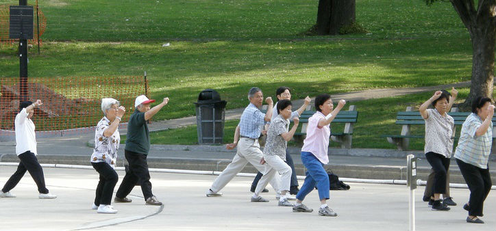 Adults exercising through tai chi